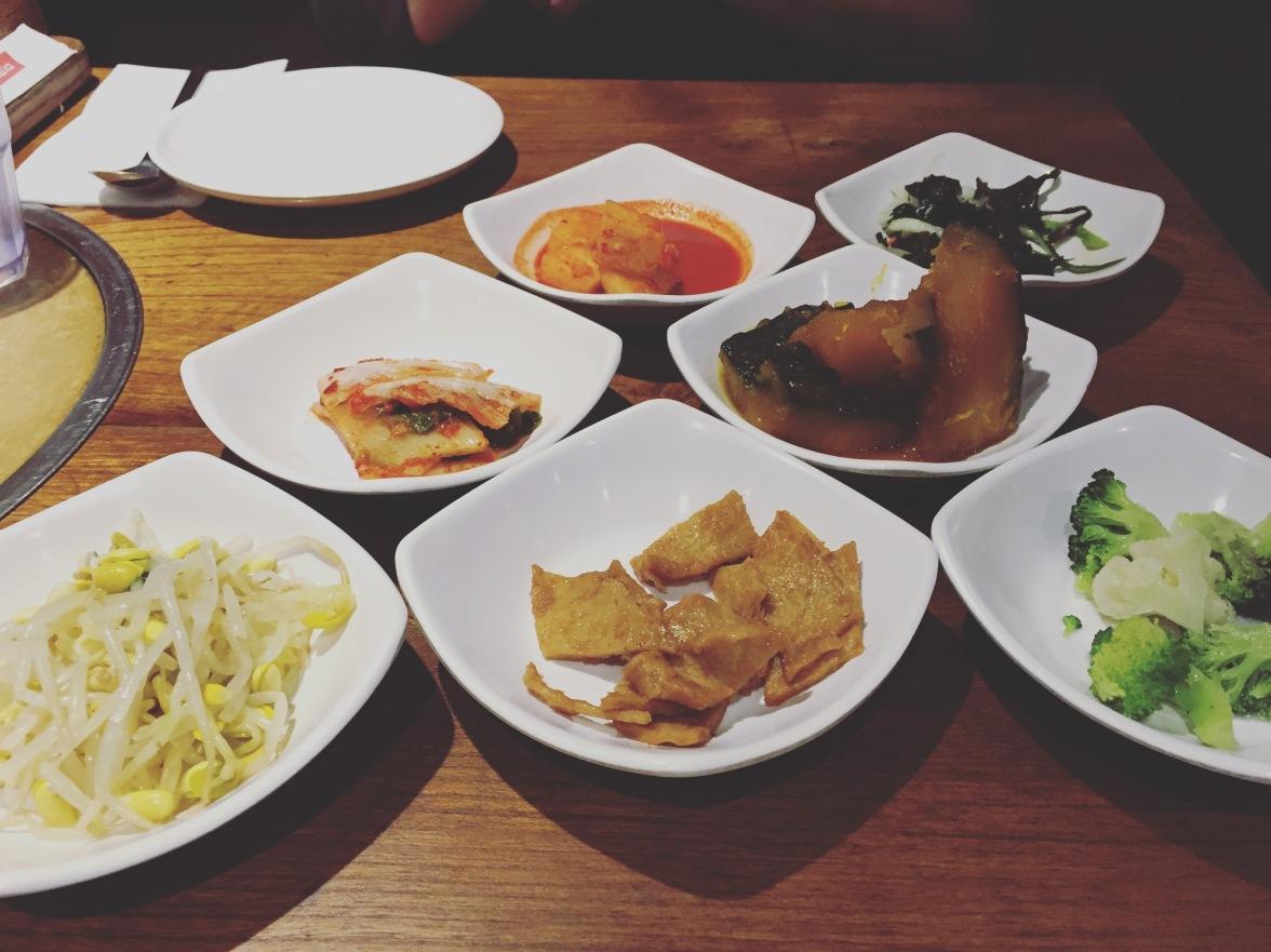 L-R: Curried potatoes, seaweed salad, kimchee, kabocha squash, bean sprout salad, sweet tofu, steamed broccoli & cauliflower